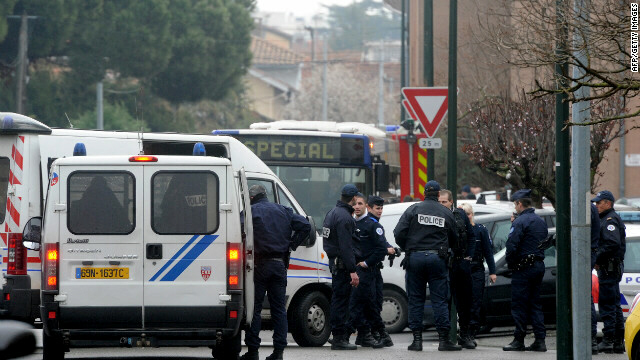 Around 300 police officers surround an apartment in Toulouse on March 21, during an operation to arrest Mohammed Merah, the man suspected of killing seven victims in three separate gun attacks. Authorities say the 23-year-old is a self-styled al Qaeda jihadist.