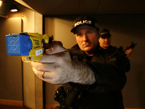 Police with taser weapons