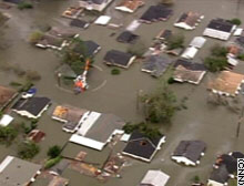 A Coast Guard helicopter flies over a Louisiana neighborhood flooded by Hurricane Katrina