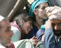 A Kashmiri family mourn for its missing family members in Muzaffarabad