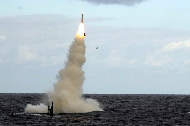 A Tomahawk missile is fired from a submarine