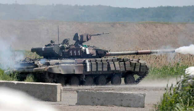 A Ukrainian tank opens fire during battle with pro-Russian fighters