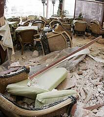 A cafeteria in Hania is strewn with rubble after the quake Sunday.