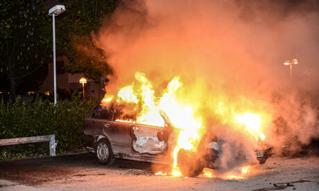 A car burns in the Stockholm suburb of Kista
