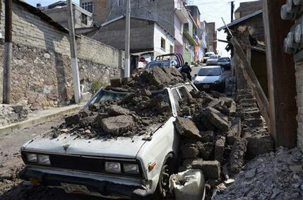 A car suffered damage from a strong earthquake in Chilpancingo, Mexico