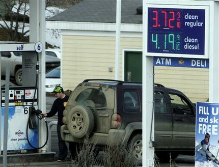 A customer fills up at an Irving Oil gas station, in Berlin, Vt