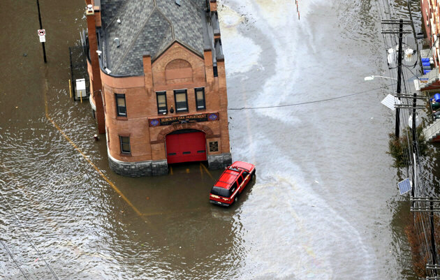 A firehouse is surrounded by floodwaters in Hoboken, NJ