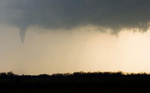 A funnel cloud is seen near Green Ridge just south of Sedalia, Missouri