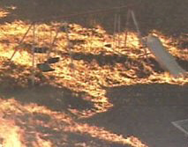 A grass fire rages through a playground in Tarrant County, Texas.