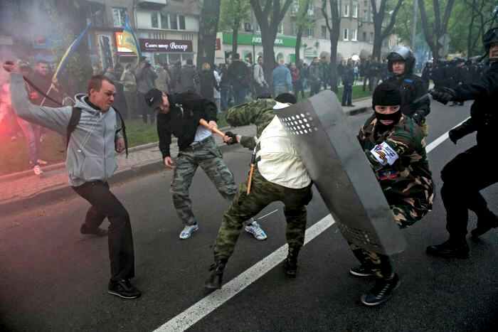 A man is attacked at barricade erected by pro-Russian activists
