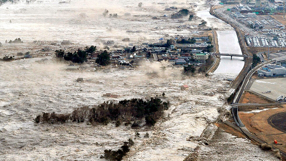 A massive tsunami slams the coastal areas of Iwanuma in Miyagi
