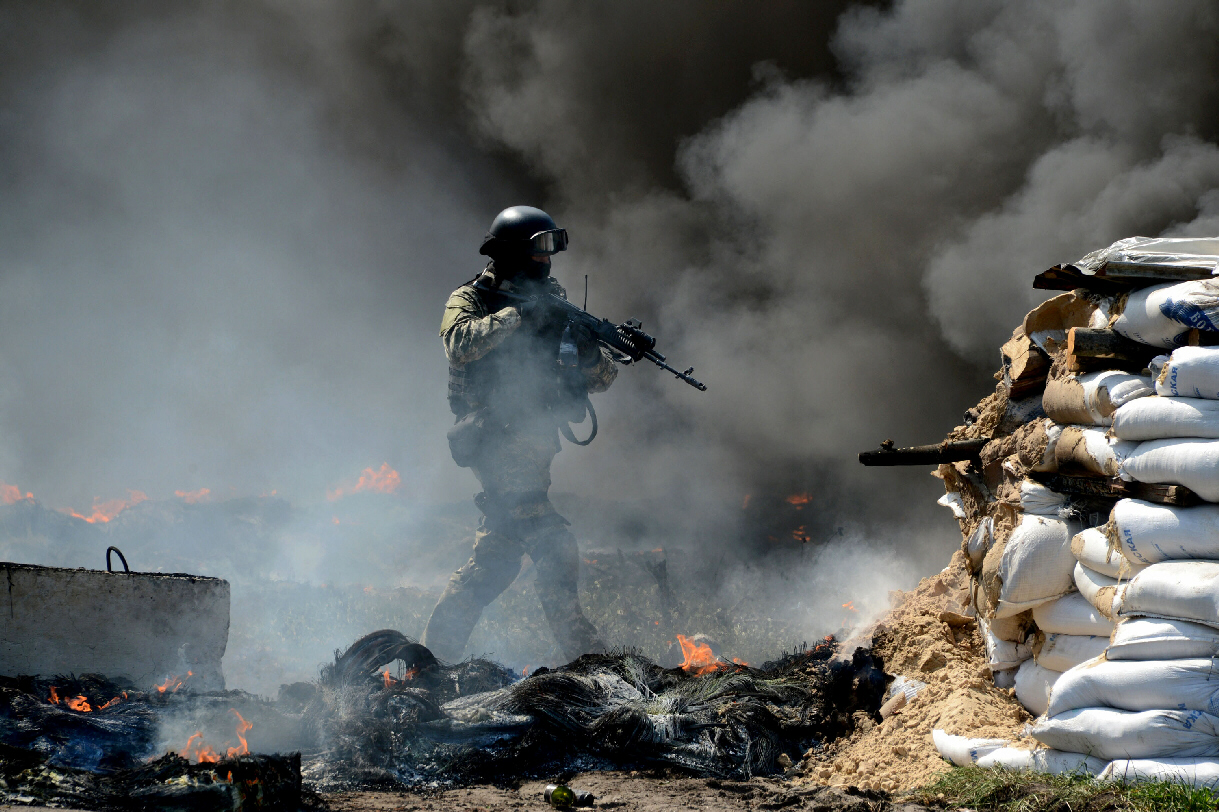 A member of Ukrainian special forces takes position at abandoned roadblock