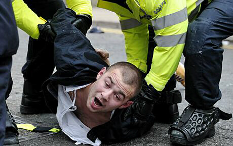 A member of the EDL is arrested during protests in Leicester