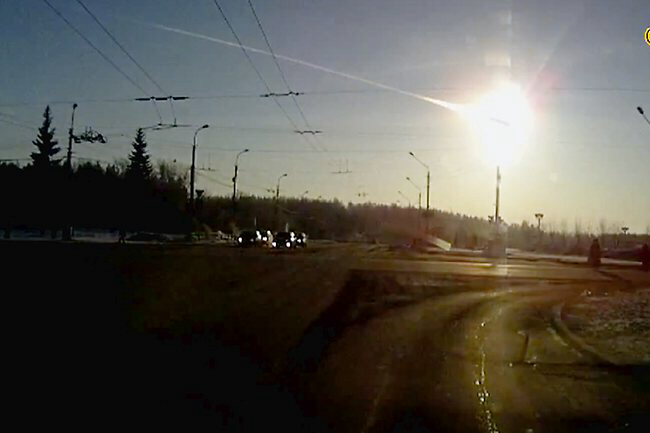 A meteor streaks through the sky over Chelyabinsk