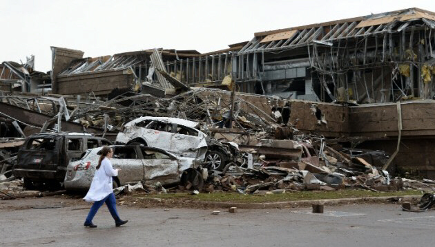 A nurse walks by the destruction at a Moore hospital on May 20