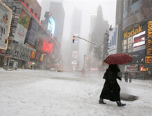 A pedestrian walks across Times Square on Saturday in New York