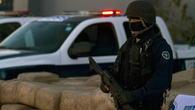 A police officer stands guard at Baja California