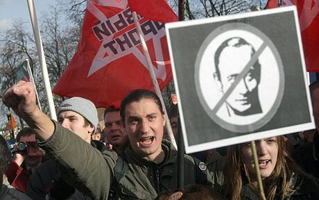 A protester holds a portrait of Russian Prime Minister Vladimir Putin during anti-government rally in Moscow Photo: EPA
