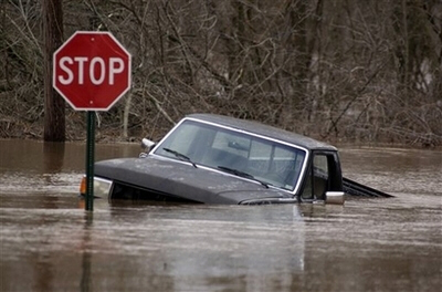 A truck is stopped by flood water near Shoal Creek, south of Joplin, Mo.