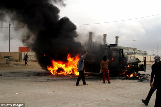 A vehicle set on fire by tribesmen and Al Qaeda in Anbar, Iraq