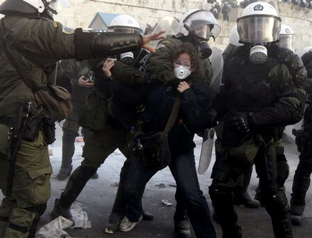 A woman is arrested by riot police in Athens' Syntagma