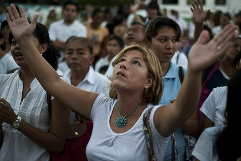 A woman prays to the Mayan moon goddess Ixchel to stop Planet X