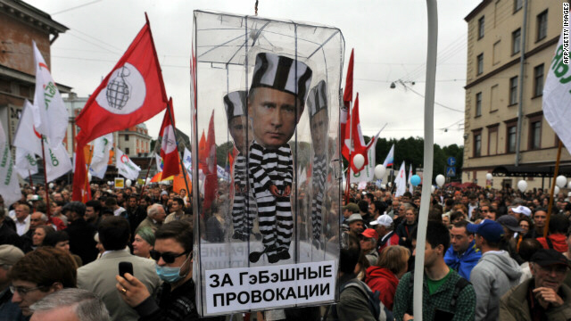 Activists carry model of prison cell with Putin during rally in St Petersburg