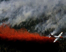 Airplane dumps fire retardant on edge of Blue Springs fire near Toquerville, Utah
