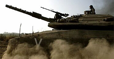 An Israeli tank on manoeuvres close to the border with Gaza