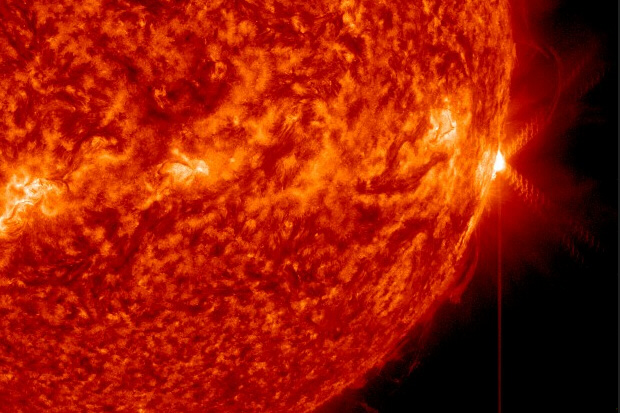 An X1.3-class solar flare (far right) erupts from the surface of the sun
