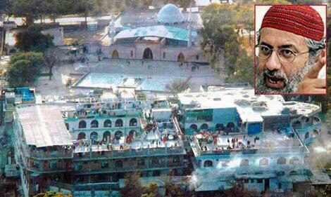 An aerial view of the Red Mosque and seminary yesterday, where Pakistani forces killed cult leader Abdul Rashid Ghazi (inset)