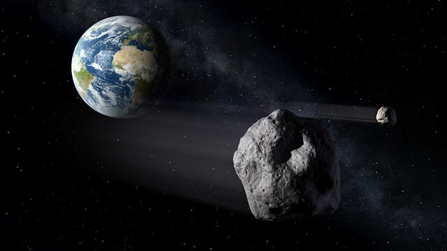 An asteroid near planet Earth can be seen in this illustration