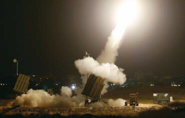 An iron dome launches rockets to intercept incoming Gaza rockets