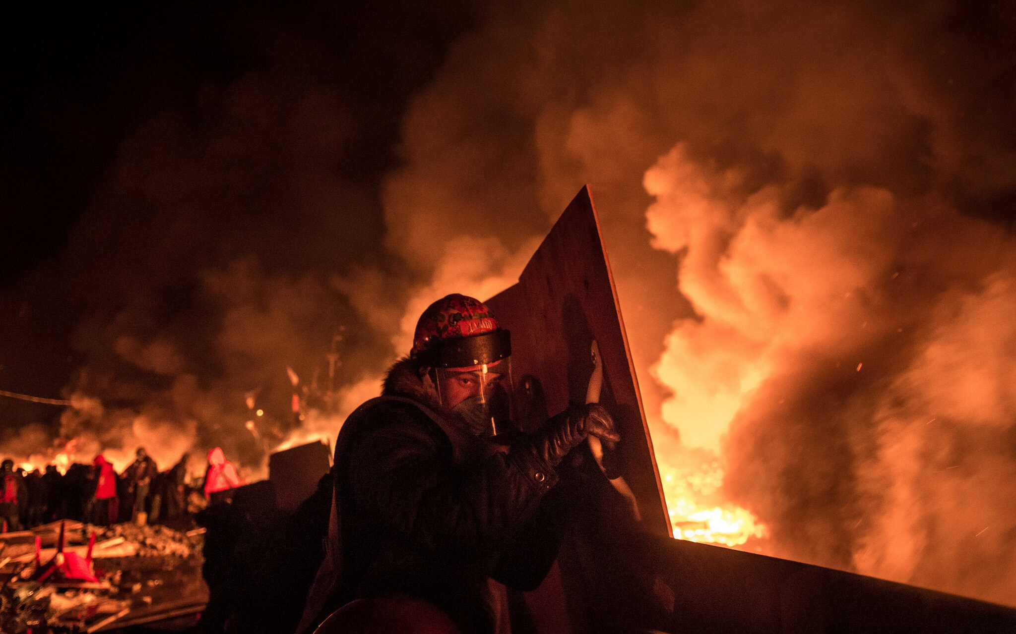 Antigovernment protesters kept barricades burning on Wednesday