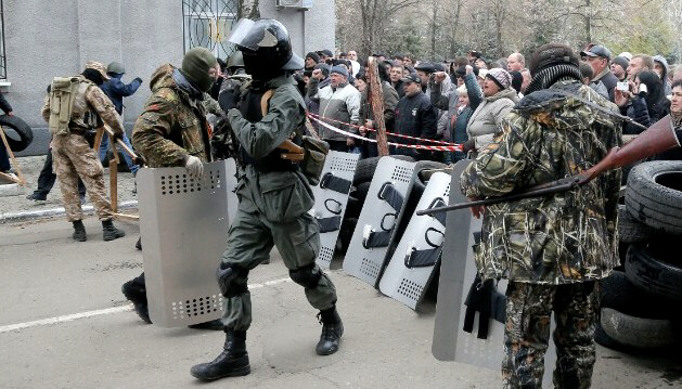 Armed pro-Russian activists with riot shields occupy police station