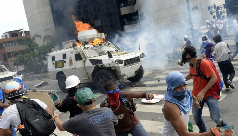 Armored vehicle plows into crowd in Venezuela