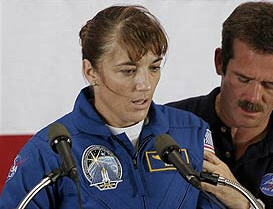 Astronaut Heidemarie Stefanyshyn-Piper is held as she collapses