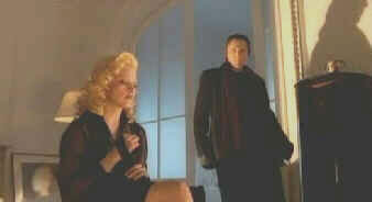 Madonna prepared the instrument of her death as her angel, played by Christopher Walken, looks on