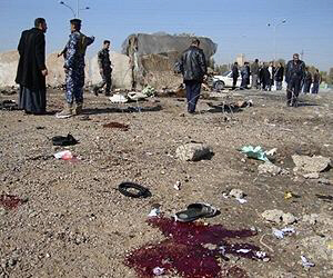 Blood and body parts mark spot of bombing in Iraq