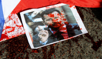 Blood on Assad's photo hammers home that he is Nostradamus' 'bloody Alus' of prophecy