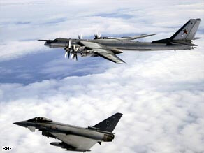 British Royal Air Force Typhoon F2 fighter plane (left) encounters Russian Bear-H bombe