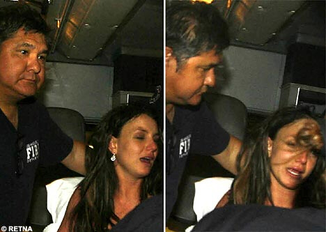 Britney appears clearly distressed in ambulance