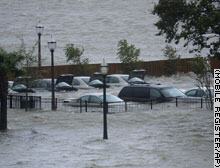 Cars are almost submerged in this parking lot in Mobile, Alabama