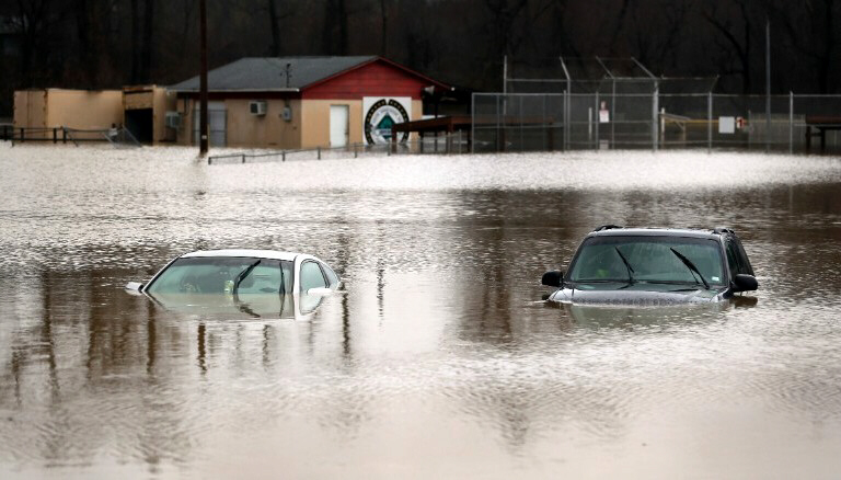 Cars are submerged in flood waters in Kimmswick, MO