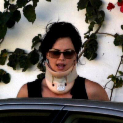 Only Charlize Theron could look sexy in a neck brace ... note blonde hair was dyed black for her role in Aeon Flux ...