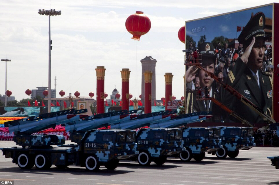 China's armed forces shows off latest weaponry at Tiananmen Square