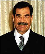 Saddam following recent cosmetic surgery to make himself appear Chinese