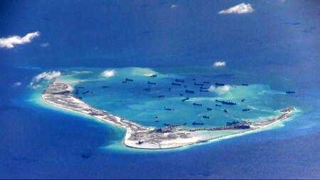 Chinese dredging vessels are seen in waters around disputed Spratly Islands