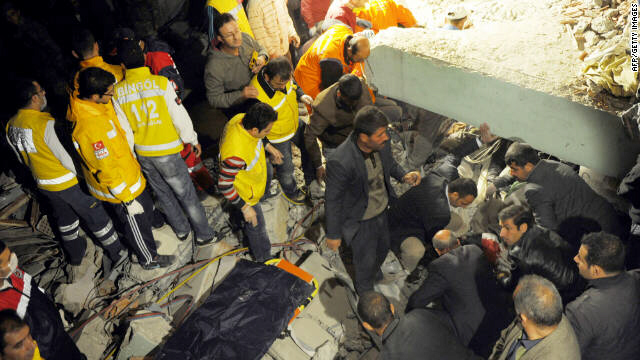 Citizens and rescue workers sift through the rubble in Ercis, Turkey