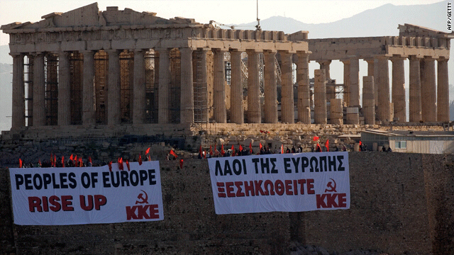 Members of the Communist Party of Greece (KKE) protest near the Parthenon on Tuesday against government cuts.